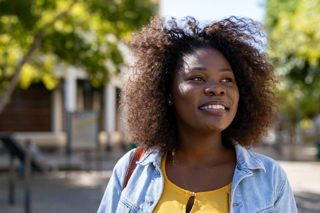 Happy black woman thinking